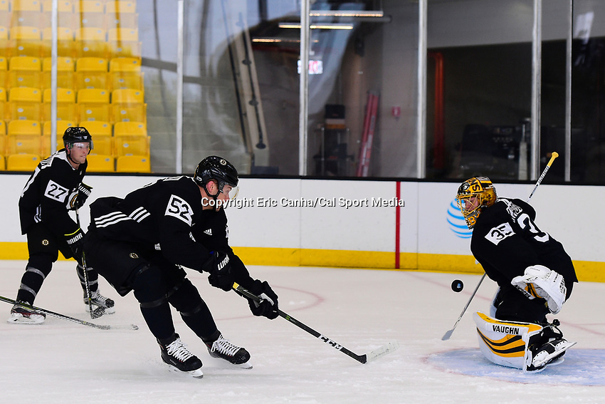 September 15, 2017: Boston Bruins center Sean Kuraly (52) shoots on goalie Anton Khudobin (35) during the Boston Bruins training camp held at Warrior Ice Arena in Brighton, Massachusetts. Eric Canha/CSM