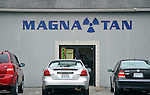 Magna Tan, tanning salon in Arab, Alabama that uses a radiation symbol as part of their logo.  Bob Gathany Photographer.