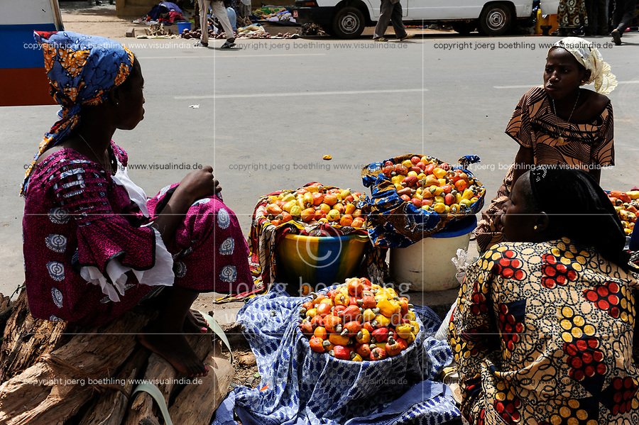 Mali, Dialakoro, market, women sell cashew fruits with nut