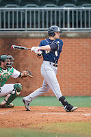 Daulton Mosbarger (4) of the Akron Zips follows through on his swing against the Charlotte 49ers at Hayes Stadium on February 22, 2015 in Charlotte, North Carolina.  The Zips defeated the 49ers 5-4.  (Brian Westerholt/Four Seam Images)
