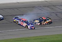 Sept. 27, 2008; Kansas City, KS, USA; NASCAR Nationwide Series driver Kyle Busch (32) spins after contact with Mike Bliss (1) during the Kansas Lottery 300 at Kansas Speedway. Mandatory Credit: Mark J. Rebilas-