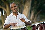 Man playing drums, smiling
