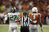 SAN ANTONIO, TX - DECEMBER 30, 2013: The University of Oregon Ducks face the University of Texas Longhorns in the 2013 Valero Alamo Bowl in the Alamodome. (Photo by Jeff Huehn)