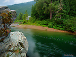 Idaho, North, Pritchard. The Blue green waters of the North Fork of the Coeur d'Alene River flowing through evergreen forests.