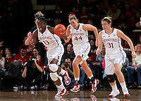 STANFORD, CA - January 27, 2013: Stanford Cardinal's Chiney Ogwumike (13), Joslyn Tinkle (44), and Toni Kokenis (31) during Stanford's 69-56 victory over the Colorado Buffaloes at Maples Pavilion in Stanford, California.