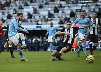 30th November 2019; St James Park, Newcastle, Tyne and Wear, England; English Premier League Football, Newcastle United versus Manchester City; Bernado Silva of Manchester City shoots wide as Federico Fernandez of Newcastle United attempts to block - Strictly Editorial Use Only. No use with unauthorized audio, video, data, fixture lists, club/league logos or 'live' services. Online in-match use limited to 120 images, no video emulation. No use in betting, games or single club/league/player publications