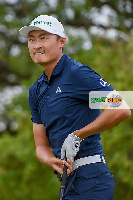 HaoTong Li (CHN) watches his tee shot on 2 during day 1 of the Valero Texas Open, at the TPC San Antonio Oaks Course, San Antonio, Texas, USA. 4/4/2019.<br /> Picture: Golffile | Ken Murray<br /> <br /> <br /> All photo usage must carry mandatory copyright credit (© Golffile | Ken Murray)
