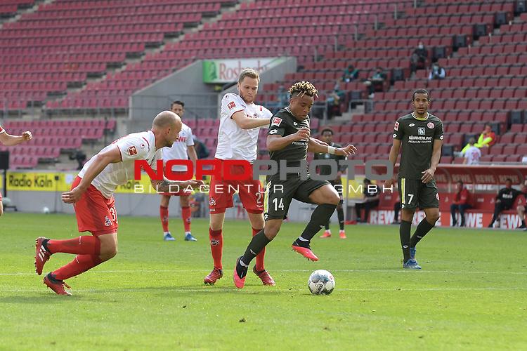 nph00351: Pierre KUNDE (1.FSV Mainz 05) auf dem Weg <br /> zum Tor zum 2-2 gegen <br /> Benno SCHMITZ (1.FC Koeln) und <br /> Toni LEISTNER (1.FC Koeln).<br /> Sport: Fussball: 1. Bundesliga: Saison 19/20: 26.Spieltag: 1.FC KOELN-FSV MAINZ 05,17.05.2020.<br /> Foto: Anke Waelischmiller/SVEN SIMON/POOL / via Meuter/nordphoto<br /> <br /> Nur für journalistische Zwecke! Only for editorial use!<br /> Gemäß den Vorgaben der DFL Deutsche Fußball Liga ist es untersagt, in dem Stadion und/oder vom Spiel angefertigte Fotoaufnahmen in Form von Sequenzbildern und/oder videoähnlichen Fotostrecken zu verwerten bzw. verwerten zu lassen. DFL regulations prohibit any use of photographs as image sequences and/or quasi-video.
