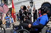 United States President Barack Obama and Vice President Joe Biden watch the Wounded Warrior Ride at the White House, in Washington, DC, April 14, 2016.  The event helps raise awareness to the public about severely injured veterans and provides rehabilitation opportunities. <br /> Credit: Aude Guerrucci / Pool via CNP