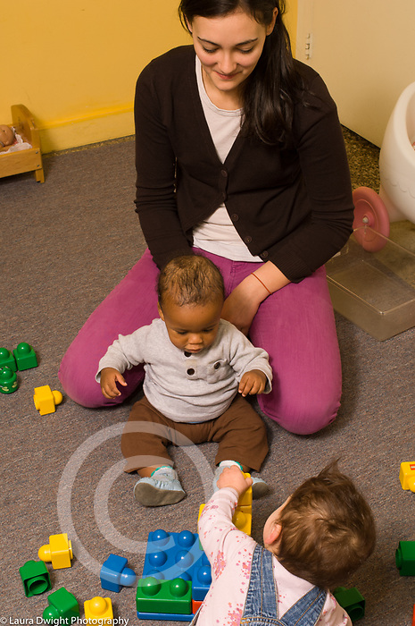 Day Care Center female caregiver with two babies