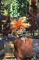 Oceania,Papua New Guinea, hull man preparing for Sing Sing dance