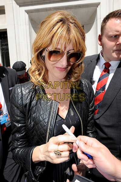 LONDON, ENGLAND - JUNE 17: Laura Dern arriving at BBC Radio 2 on 17th June 2014 in London, England.<br /> CAP/IA<br /> &copy;Ian Allis/Capital Pictures