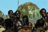 "The El Molo are the smallest ethnic group in Kenya - 25 people in the Seventies, 200 today. For some time now the El Molo have been intermingling with their neighbours the Samburu and Turkana, and nowadays no-one still speaks the language of their forebears. They live on lava rock on the south-east shore of Lake Turkana. Their dwellings resemble ""abandoned nests of ancient prehistoric birds"" (Alberto Moravia), constructed with Dum palm trunk. This tiny population fishes the lake for Nile perch and tilapia; they occasionally hunt crocodiles and hippos."