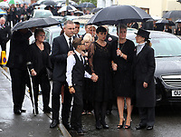 "COPY BY TOM BEDFORD<br /> Pictured: Gemma Black, Pearl's mum (C) joined by family and friends arrives at the Jerusalem Baptist Chapel in Merthyr Tydfil, Wales, UK. Friday 18 August 2017<br /> Re: The funeral of a toddler who died after a parked Range Rover's brakes failed and it hit a garden wall which fell on top of her will be held today at Jerusalem Baptist Chapel in Merthyr Tydfil.<br /> One year old Pearl Melody Black and her eight-month-old brother were taken to hospital after the incident in south Wales.<br /> Pearl's family, father Paul who is The Voice contestant and mum Gemma have said she was ""as bright as the stars""."