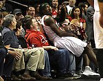 04/03/11--Blazers' Gerald Wallace sits on a fan's lap after going for a loose ball in the second half of Portland's 104-96 win over Dallas at the Rose Garden in Portland, Or.. Photo by Jaime Valdez.........................................