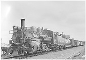 Front 3/4 angle view of K-28 #473 with mixed train at Taos Junction, NM.<br /> D&amp;RGW  Taos Junction, NM  Taken by Maxwell, John W. - 8/30/1941
