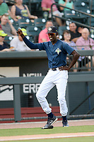 Ronny Mauricio (2) of the Columbia Fireflies, who was not in the lineup,  participates in between-innings entertainment by doing a little dance during a game against the Augusta GreenJackets on Saturday, June 1, 2019, at Segra Park in Columbia, South Carolina. Columbia won, 3-2. (Tom Priddy/Four Seam Images)