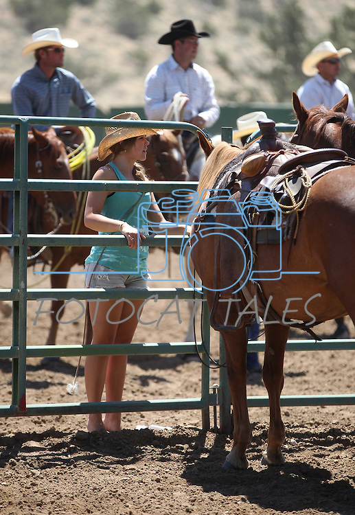Cassi Uhart watches the branding event at the Minden Ranch Rodeo on Sunday, July 24, 2011, in Gardnerville, Nev. .Photo by Cathleen Allison