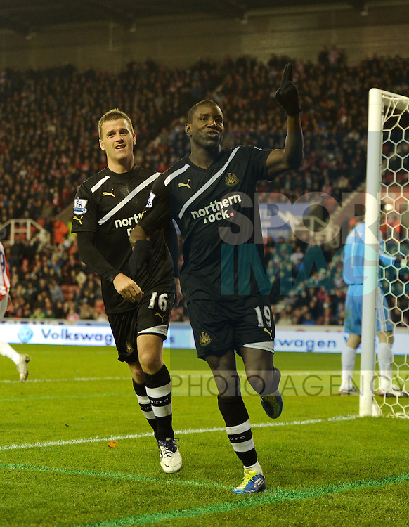 Demba Ba of Newcastle United celebrates scoring from the penalty spot