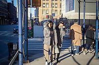 Intrepid Asian tourists in the trendy gallery district in West Chelsea battle the cold and windy weather on Saturday, February 4, 2017. (©Richard B. Levine)