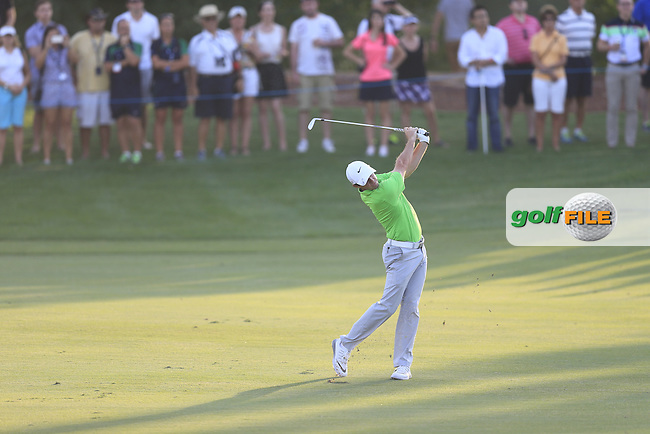 Rory McIlroy (NIR) third shot on the 18th during Round 1 of the DP World Tour Championship at the Earth course,  Jumeirah Golf Estates in Dubai, UAE,  19/11/2015.<br /> Picture: Golffile | Thos Caffrey<br /> <br /> All photo usage must carry mandatory copyright credit (&copy; Golffile | Thos Caffrey)