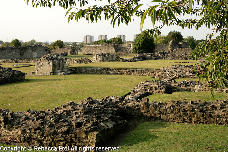 The ruins of Lesnes Abbey with the apartment blocks of Thamesmead in the background, Abbeywood, southeast London, UK