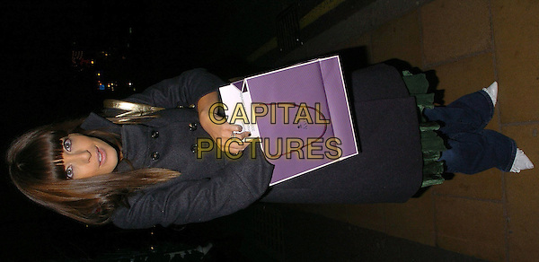 "CLAUDIA WINKLEMAN.""Women Working"" Launch party, Asprey, New Bond Street,  London, December 9th 2004..full length goody bag.Ref: CAN.www.capitalpictures.com.sales@capitalpictures.com.©Capital Pictures."