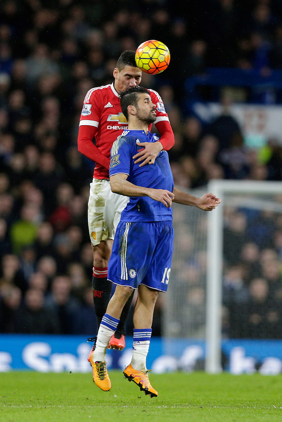 Manchester United's Chris Smalling battles for possession with Chelsea's Diego Costa<br /> <br /> Photographer Craig Mercer/CameraSport<br /> <br /> Football - Barclays Premiership - Chelsea v Manchester United - Sunday 7th February 2016 - Stamford Bridge - London<br /> <br /> &copy; CameraSport - 43 Linden Ave. Countesthorpe. Leicester. England. LE8 5PG - Tel: +44 (0) 116 277 4147 - admin@camerasport.com - www.camerasport.com