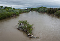 The Arkansas River in Crowley County, Colorado, Tuesday, May 17, 2016. Crowley County, once a thriving agricultural community with over 50,000 acres of farm land, sold it's water rights the City of Aurora for municipal use and now farms a little more than 5,000 acres of land. The result has seen dried and dead farm land and abandoned homesteads. Crowley County represents a dire look at how mismanaged water rights can have devastating effects on an already drought prone region.<br /> <br /> Photo by Matt Nager