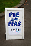 A sign advertising pie and peas inside the Harry Williams Riverside Stadium, home to Ramsbottom United before they played Barwell in a Northern Premier League premier division match. This was the club's 13th league game of the season and they were still to record their first victory following a 3-1 defeat, watched by a crowd of 176. Rams bottom United were formed by Harry Williams, the current chairman, in 1966 and progressed from local amateur football  in Bury to the semi-professional leagues.
