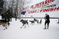 Sunday February 28, 2010  Anitra Winkler crosses the finish line in 2nd place of the Junior Iditarod . Willow , AK