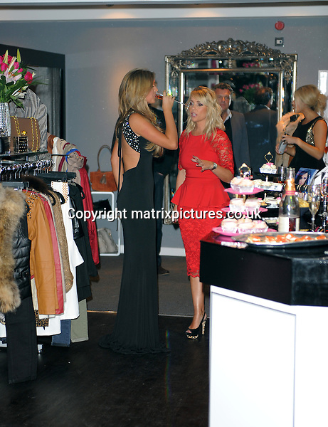 NON EXCLUSIVE PICTURE: MATRIXPICTURES.CO.UK.PLEASE CREDIT ALL USES..WORLD RIGHTS..TOWIE star Lucy Mecklenburgh is pictured at the opening of her new boutique store...DECEMBER 5th 2012..REF: LTN 125763