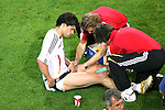 04 July 2006: Trainers work on the legs of Michael Ballack (GER) (left) during the break between regulation and overtime. Italy defeated Germany 2-0 in overtime at Signal Iduna Park, better known as Westfalenstadion, in Dortmund, Germany in match 61, the first semifinal game, in the 2006 FIFA World Cup.