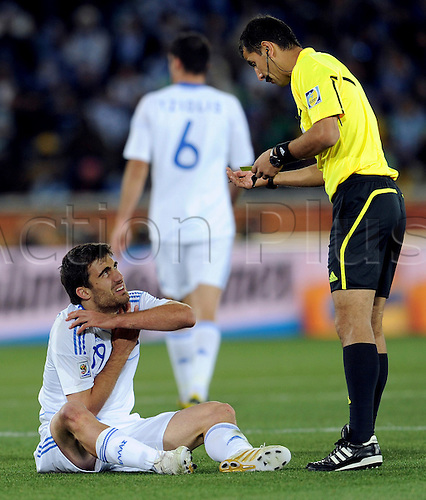 POLOKWANE, June 23, 2010  Sokratis Papastrathopoulos of Greece (bottom L) talks to the referee during the 2010 World Cup Group B soccer match against Argentina in Polokwane, South Africa, June 22, 2010. Argentina won 2-0 and qualifies for the next round.