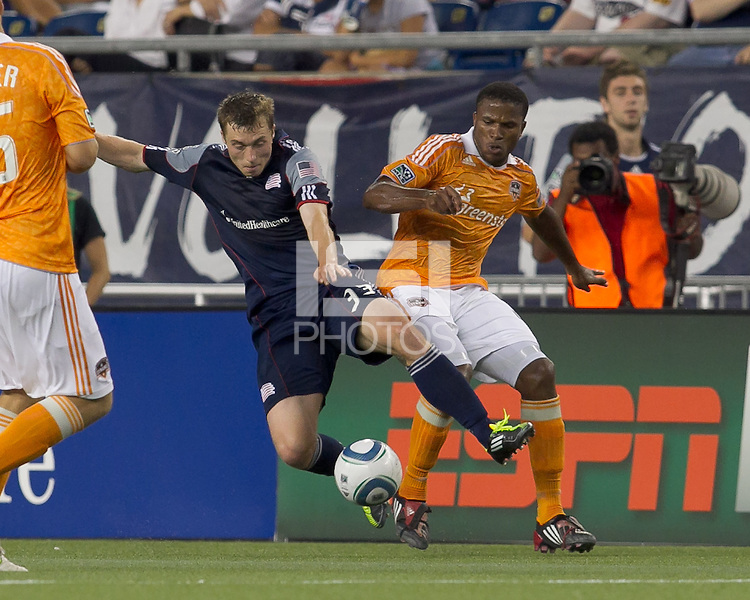 New England Revolution midfielder Zak Boggs (33) with extra effort to intercept pass to Houston Dynamo defender Jermaine Taylor (4). In a Major League Soccer (MLS) match, the New England Revolution tied Houston Dynamo, 1-1, at Gillette Stadium on August 17, 2011.