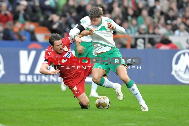 FBL 2008/2009 24. Spieltag Rueckrunde<br />  Werder Bremen - VFB Stuttgart<br /> <br /> Christian Tr&auml;sch ( VFB #35 ) gegen Sebastian Boenisch ( Bremen GER #2 )<br /> <br /> Foto &copy; nph (nordphoto )