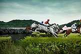 USA, Tennessee, Nashville, Iroquois Steeplechase, horses and their jockeys jump a barrier during the 5th race of the day