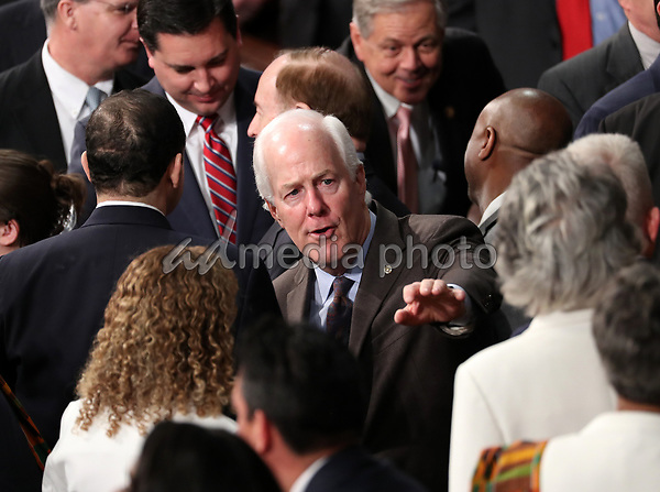 United States Senator John Cornyn (Republican of Texas) waves to a colleague prior to US President Donald J. Trump delivers his second annual State of the Union Address to a joint session of the US Congress in the US Capitol in Washington, DC on Tuesday, February 5, 2019. Photo Credit: Alex Edelman/CNP/AdMedia