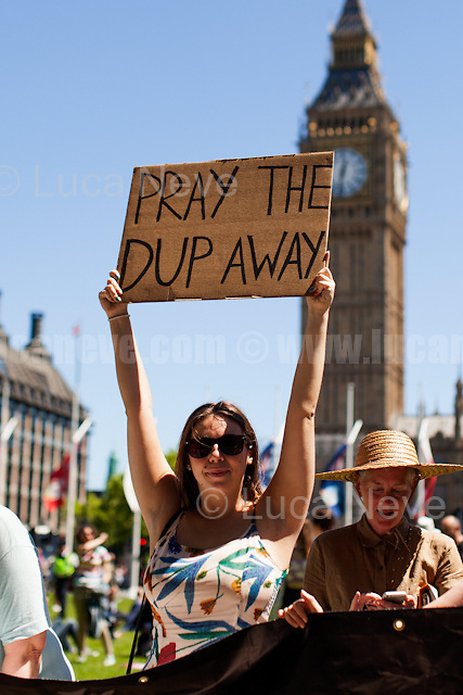 London, 10/06/2017. Today, hundreds of people held a demonstration in Parliament Square to protest against the election of Theresa May who will lead the next British Government supposedly in coalition with the Democratic Unionist Party (DUP - http://bit.ly/2s93eHf), the largest unionist political party in Northern Ireland led by Arlene Foster. At the end of the rally, some of the protesters marched to Downing Street.<br />