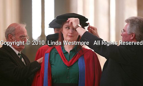 "Students, with the help of the university ""Dressers"", prepare for their graduation ceremony, University of Surrey."