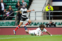 Marland Yarde of England dives over to score past Gio Aplon of Barbarians during the match between England and Barbarians at Twickenham Stadium on Sunday 31st May 2015 (Photo by Rob Munro)