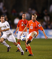 Wake Forest Demon Deacons midfielder Corben Bone (10) watches Virginia Tech Hokies midfielder James Gilson (20) during an NCAA College Cup semi-final match at SAS Stadium in Cary, NC on December 14, 2007. Wake Forest defeated Virginia Tech 2-0.