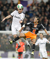 Real Madrid's Xabi Alonso against Valencia's Nelson Valdez during King's Cup match. January 15, 2013. (ALTERPHOTOS/Alvaro Hernandez) /NortePhoto