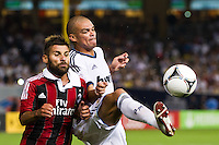 Pepe (3) of Real Madrid plays the ball under pressure from Antonio Nocerino (8) of A. C. Milan. Real Madrid defeated A. C. Milan 5-1 during a 2012 Herbalife World Football Challenge match at Yankee Stadium in New York, NY, on August 8, 2012.