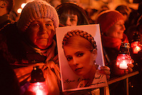 The crowd mourns the victim of Maidan square holding light candles, pictures of Yulia Tymoshenko and singing all night long.