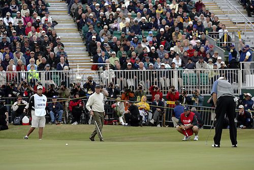 18 July 2004: American golfer TODD HAMILTON (USA) watches on the 18th green during the play-off as Ernie Els misses his vital birdie attempt in The Open Championship, played at Royal Troon, Scotland. Hamilton and Els had tied on 274 Photo: Glyn Kirk/Action Plus...golf golfers 040718 putting putt putts british