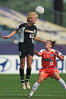 Anita Rapp of the Power goes up for a header as Betsy Barr watches. The San Jose CyberRays were defeated by the NY Power 2-1 on 7/05/03 at Mitchel Athletic Complex, Uniondale, NY..