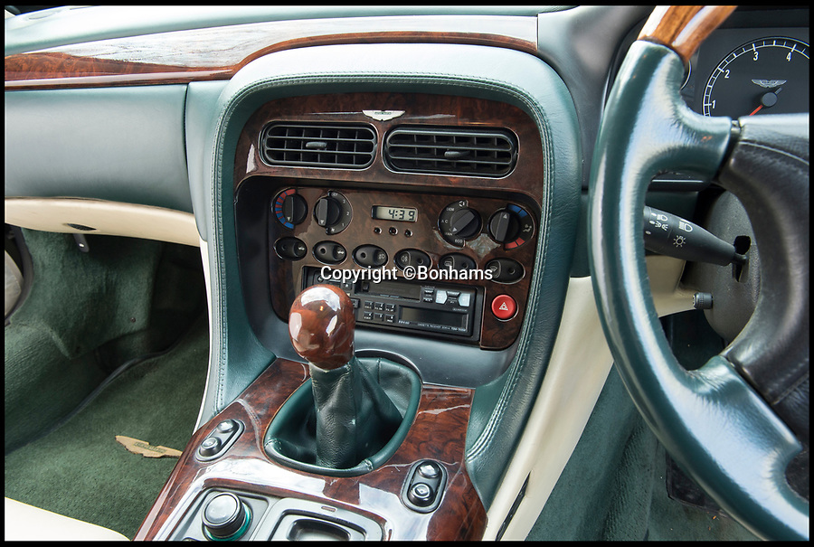 BNPS.co.uk (01202 558833)Pic: Bonhams/BNPS<br /> <br /> Casette player is still fitted.<br /> <br /> By Royal Appointment - The Aston Martin DB7 built for Prince Andrew in 1996. <br /> <br /> An Aston Martin convertible, formerly owned by HRH Prince Andrew, has emerged for sale for just £35,000.<br /> <br /> The green DB7 was built specifically for the Prince and his family in 1996 and he owned it for the first year of its life.<br /> <br /> The Duke of York eventually parted with the bespoke sports car in 1997 and since then it has been in the hands of a number of different owners - all of whom have kept it to an exceptionally high standard.<br /> <br /> A photograph remains to this day of Andrew driving the car with his then wife Sarah Ferguson in the passenger seat. The couple were accompanied by their two young children Princess Eugenie and Princess Beatrice, who were sat in the back.