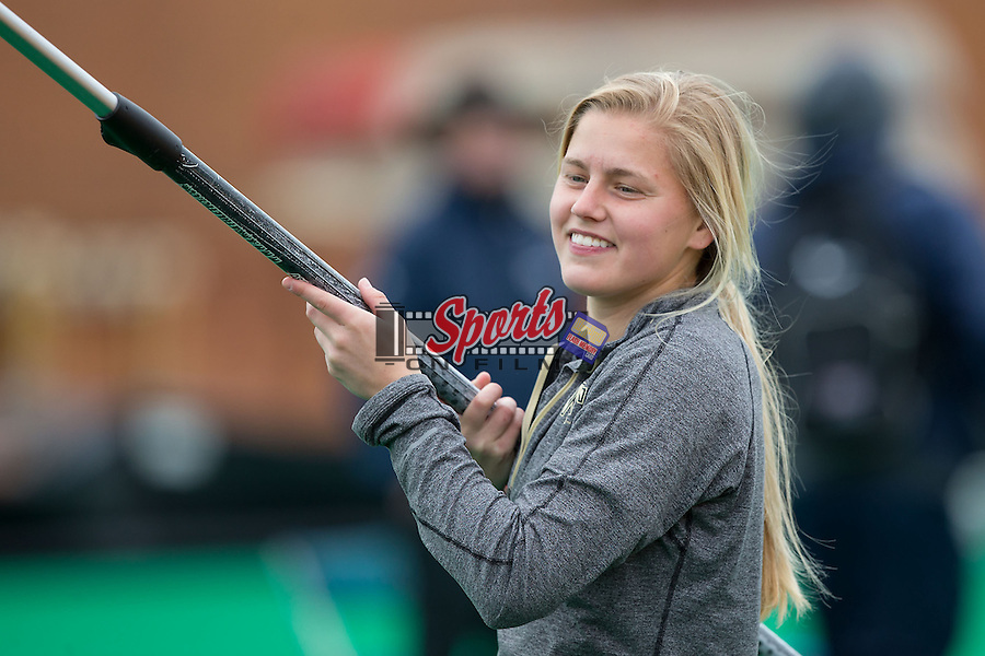 Wake Forest field hockey player Krysta Wangerin assists with the men's pole vault at the Wake Forest Open on March 20, 2015 in Winston-Salem, North Carolina.  (Brian Westerholt/Sports On Film)