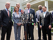 United States Senate Minority Leader Chuck Schumer (Democrat of New York) makes a statement as he and other Democratic members of the US House and Senate speak to reporters at the White House in Washington, DC after meeting with US President Donald J. Trump on April 30, 2019.  Pictured from left to right: US Representative Richard Neal (Democrat of Massachusetts), Speaker of the US House of Representatives Nancy Pelosi (Democrat of California), US Senator Ron Wyden (Democrat of Oregon), Leader Schumer, US House Assistant Democratic Leader James Clyburn (Democrat of South Carolina), and US Representative Ben Ray Lujan (Democrat of New Mexico).<br /> Credit: Ron Sachs / CNP